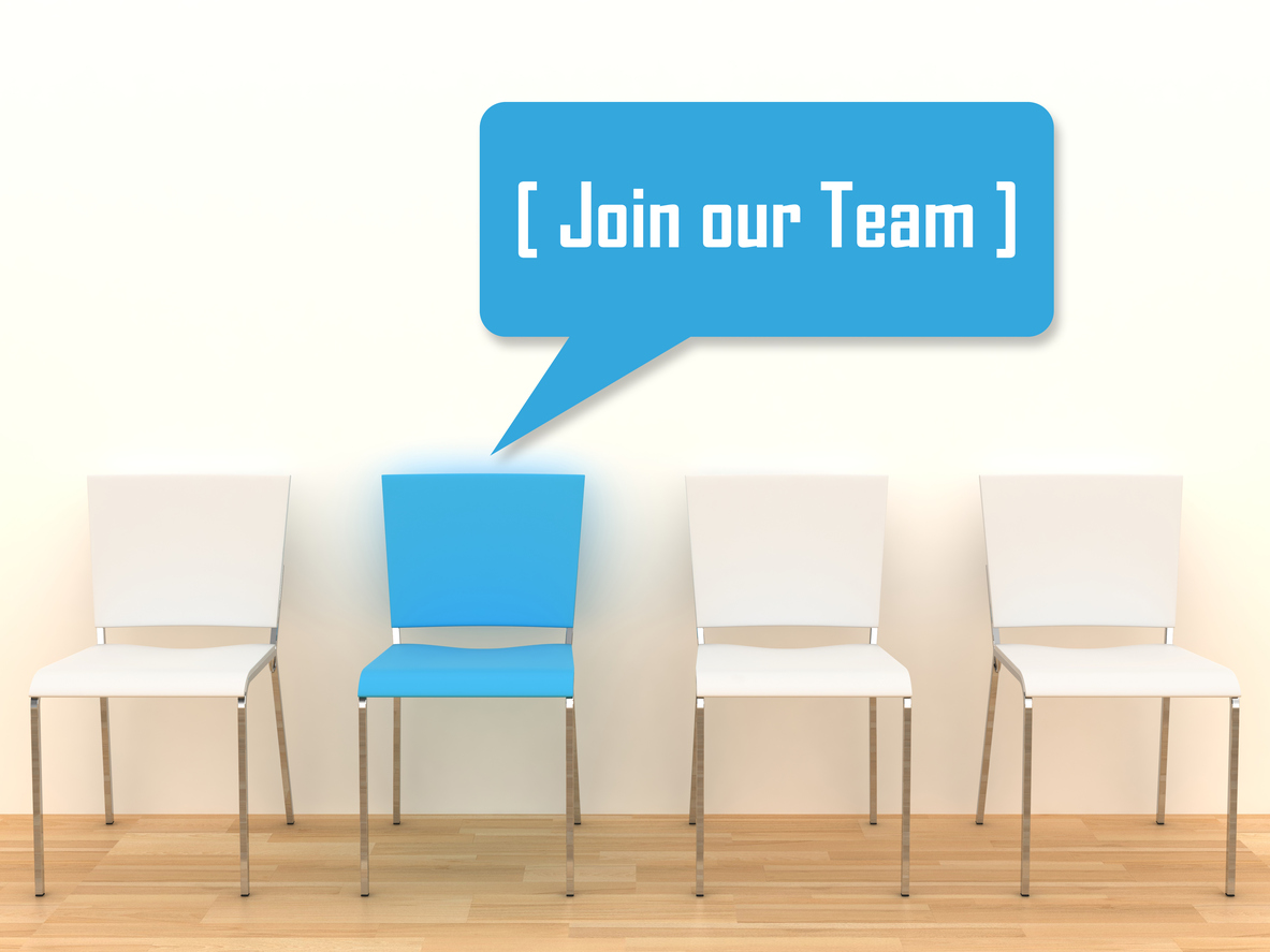 """A photo of four chairs. Three are white and one is blue. The blue chair has a dialogue bubble - graphically added to the photo - that says, """"Join our team."""""""