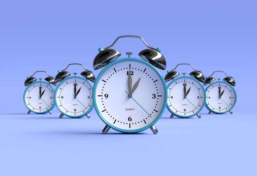 Five clocks at 1:00 on a purple background.