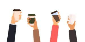 people holding up coffee