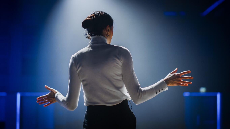 Woman giving presentation.