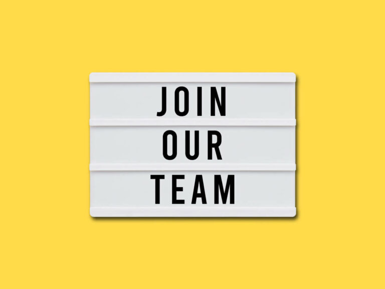 sign join our team with yellow background